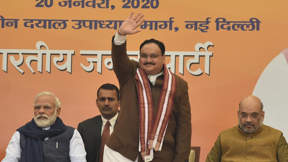 Newly elected BJP President JP Nadda waves at the gathering in the presence of Prime Minister Narendra Modi and Union Home Minister Amit Shah, at BJP headquarters, in New Delhi.