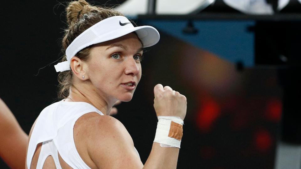 Romania's Simona Halep reacts during the match against Jennifer Brady.