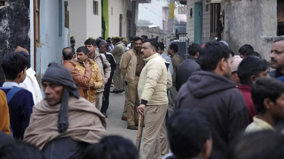 A team of police personnel was deployed in Sarfabad village, Noida,  to ensure law and order after the death of a 20-year-old woman, in Noida,  Monday, January 20, 2020.