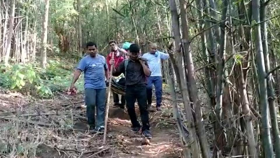 A doctor and his team of health workers carrying the pregnant woman on a stretcher in Odisha's Malkangiri district.