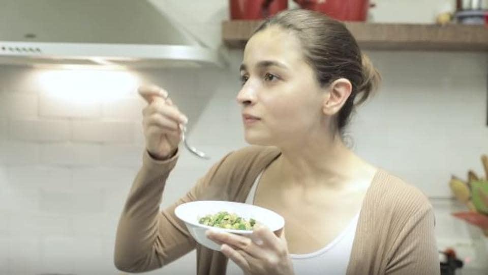 Alia Bhatt tastes her zucchini sabzi.