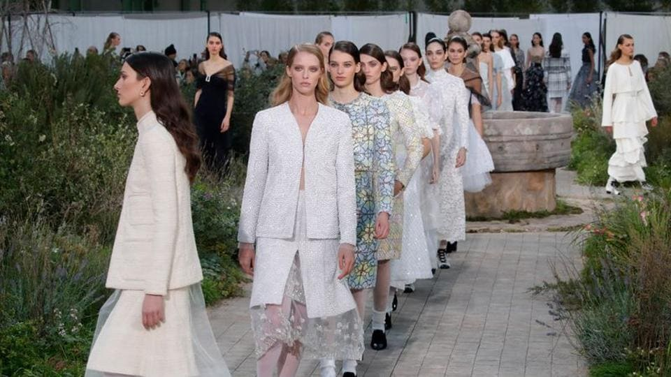 Models present creations by designer Virginie Viard as part of her Haute Couture Spring/Summer 2020 collection show for fashion house Chanel in Paris, France.