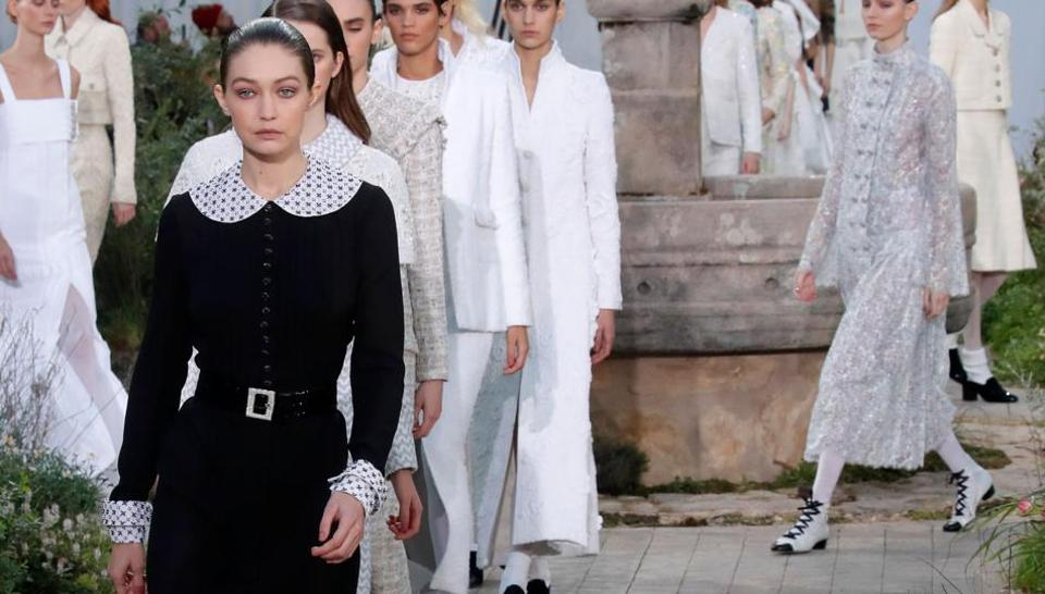 Model Gigi Hadid presents a creation by designer Virginie Viard as part of her Haute Couture Spring/Summer 2020 collection show for fashion house Chanel in Paris, France.
