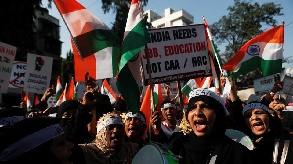 Demonstrators hold placards and national flags during a protest against a new citizenship law in Mumbai, India.