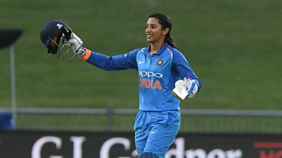 Smriti Mandhana celebrates scoring 100 runs.