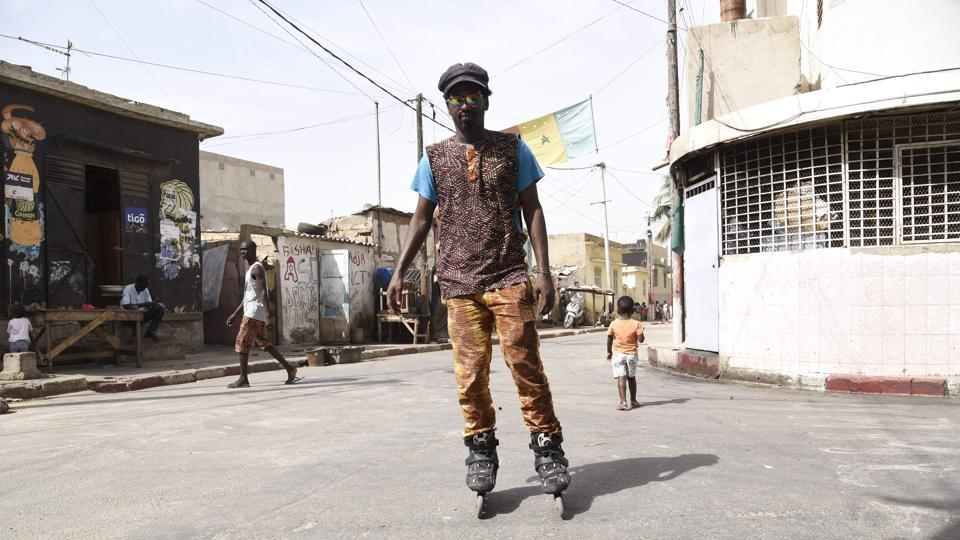 Mamadou Boye Diallo, an art curator with a penchant for heart-shaped glasses, calls Dakar's working-class Medina neighbourhood an open-air museum. Flitting on rollerblades between colourful murals in this part of the West African metropolis, Diallo, who is also a guide to the area, points to works by artists from all over the world. (Seyllou / AFP)