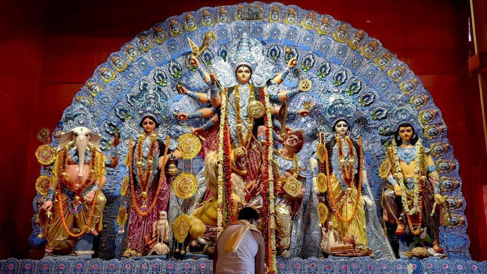 """A priest offers Maha Ashtami """"Sandhi Puja"""" at a Puja pandal during the ongoing Durga Puja festival.(PTI)"""