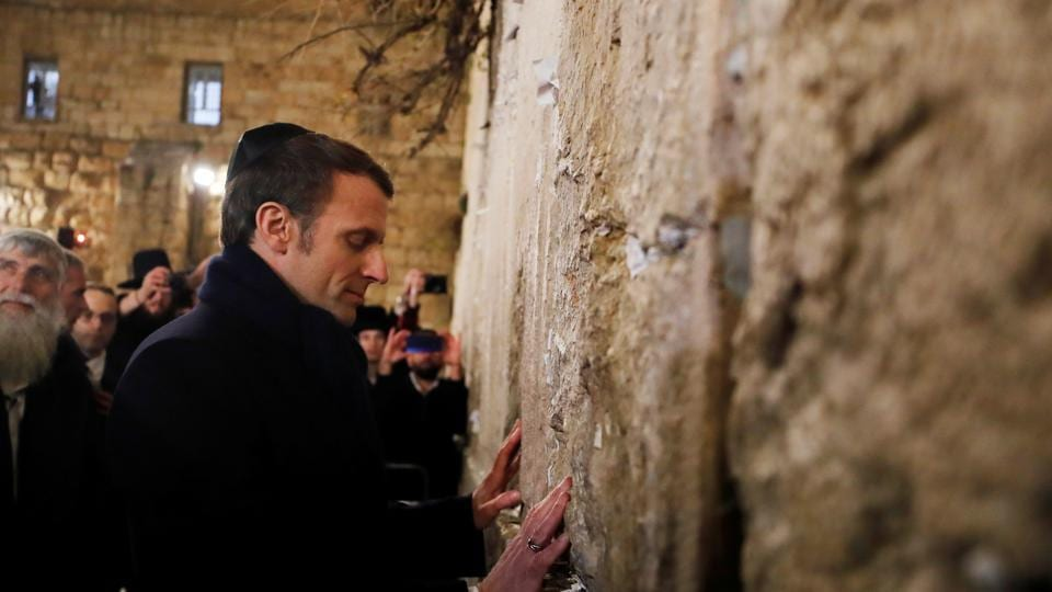 French President Emmanuel Macron stands by the Western Wall, the holiest site where Jews can pray in Jerusalem's Old City, during a visit in Jerusalem January 22, 2020.