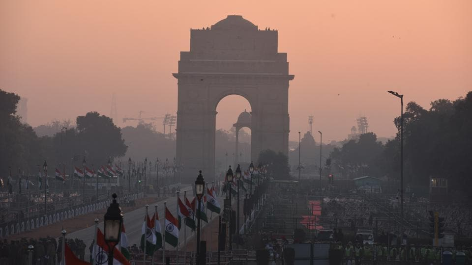 A view of India Gate around sunrise ahead of the full dress rehearsal of the Republic Day parade. Commuters in several parts of the national capital, especially central Delhi, woke to heavy traffic jams Thursday morning due to cordons for the full dress rehearsal of the parade. (Sonu Mehta / HT Photo)