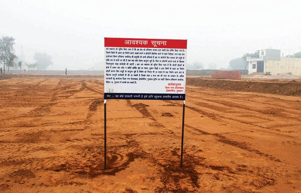 A notice board, warning against illegal construction, erected on a government plot at Dumaspur village, located along Sohna Road.