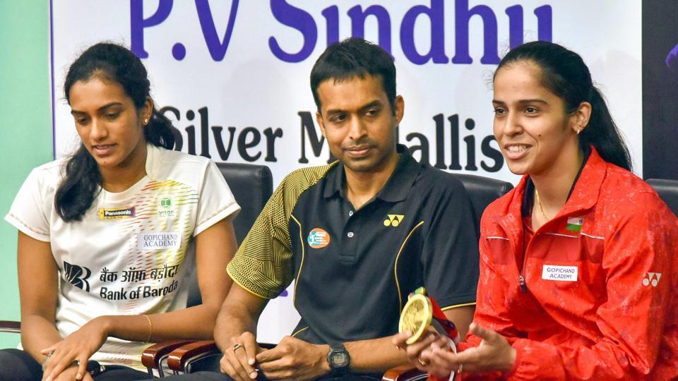 Indian badminton coach P Gopichand with PV Sindhu andSaina Nehwal.