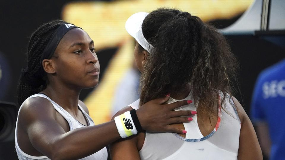 Coco Gauff, left, of the US is congratulated by Japan's Naomi Osaka.