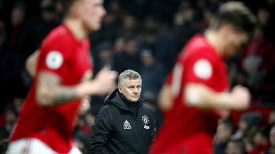 Manchester United manager Ole Gunnar Solskjaer, centre, watches the action from the touchline, during the English Premier League soccer match between Manchester United and Burnley, at Old Trafford, in Manchester.