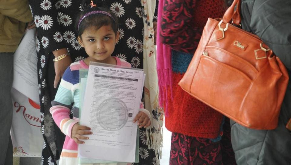 Parents in queue for submission form of Nursery class Admission