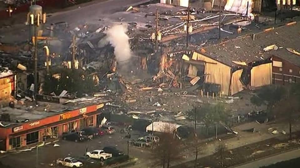 A large explosion left rubble scattered in the area, damaged nearby homes and was felt for miles away. A fire continues to burn and people have been told to avoid the area. (KTRK-TV via AP)