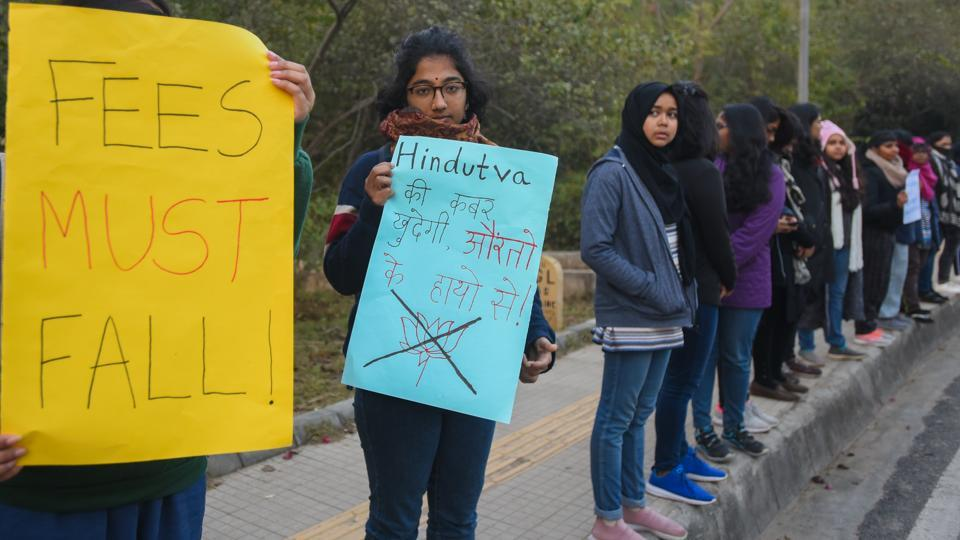 Women holding a poster during a demonstration against fee hike and Hindutva terror in Jawaharlal Nehru University, at JNU, in New Delhi, India, on Friday, January 10, 2020.