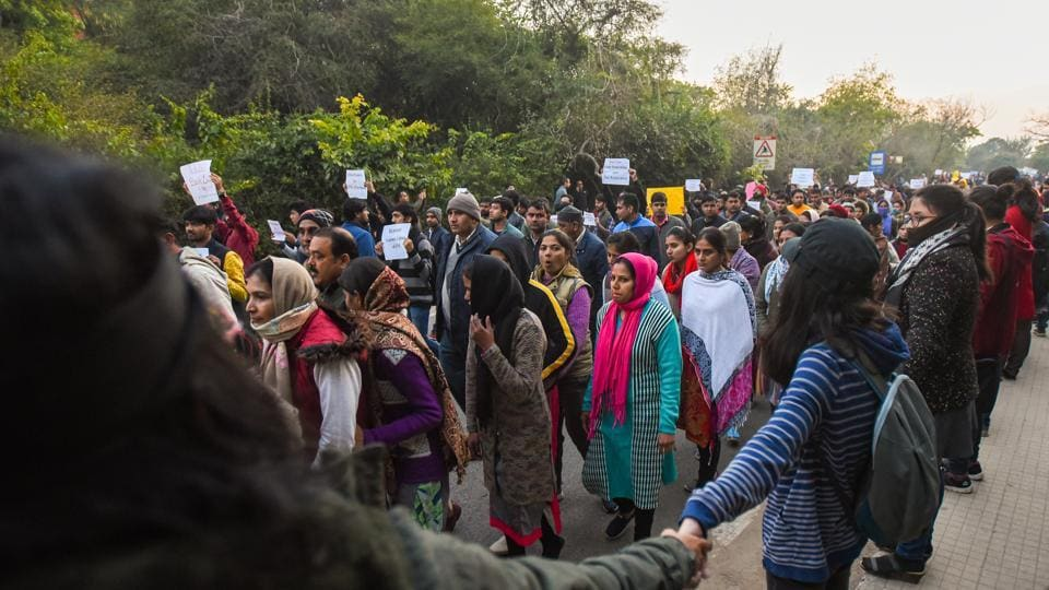 A march denouncing 'Left terror' and the disruption of registration process takes place while a counter demonstration is held on the sidewalk against fee hike and the violence that unfolded in Jawaharlal Nehru University (JNU) on January 5.