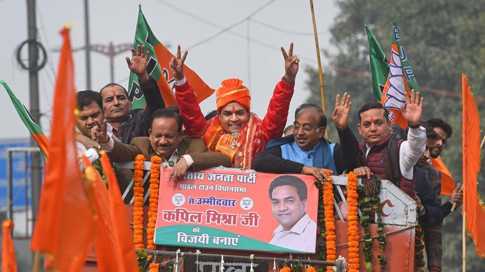 BJP candidate from Model Town Kapil Mishra during a road show before filing the nomination for Delhi assembly election, on Tuesday.