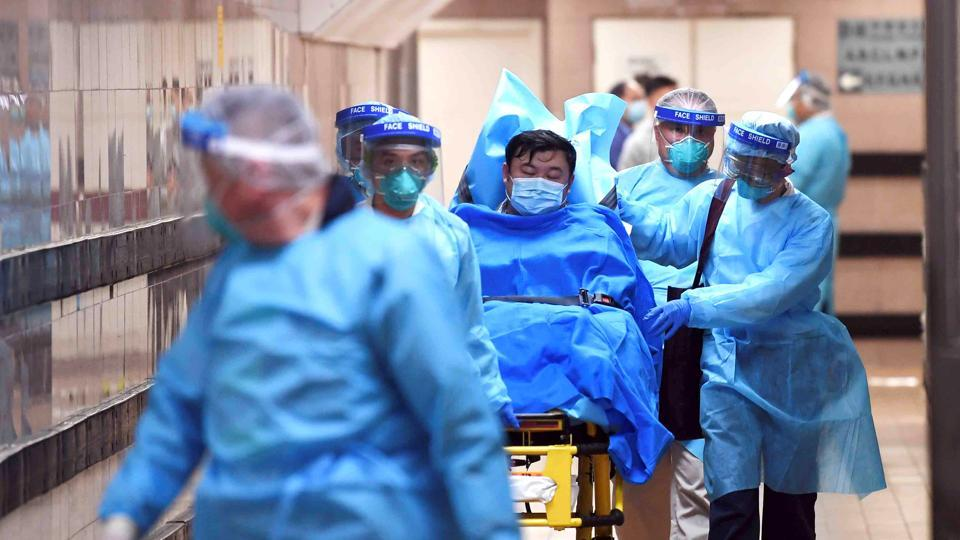 Medical staff transferring a patient of a highly suspected case of a new coronavirus at the Queen Elizabeth Hospital in Hong Kong, China on January 22, 2020.