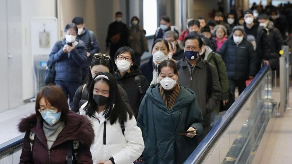 Passengers arriving from the Chinese city of Wuhan arrive at Narita Airport in Chiba, Japan.
