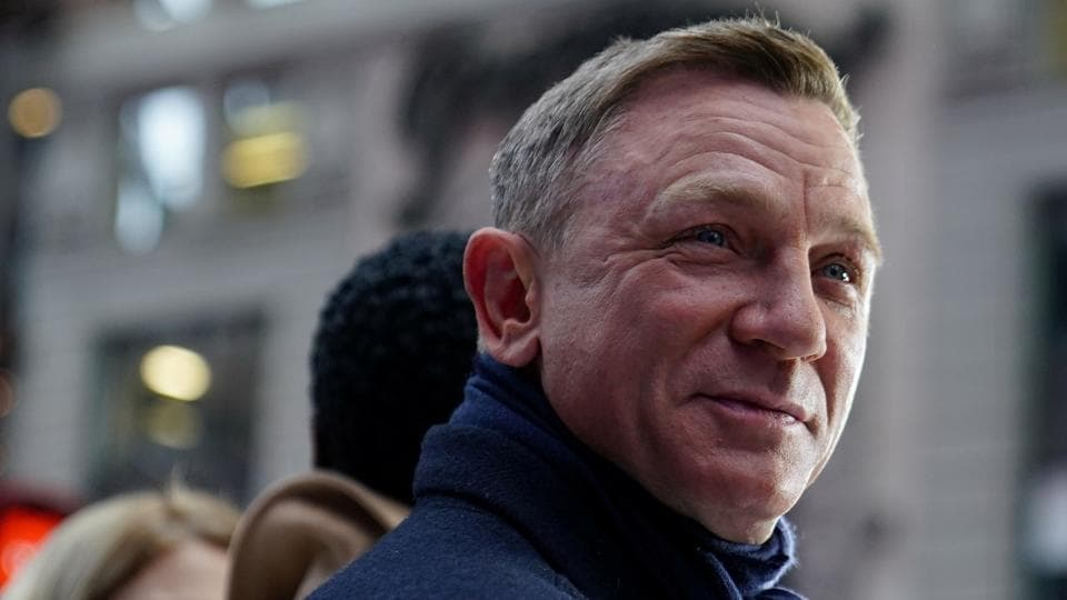 Actor Daniel Craig reacts during a promotional appearance on TV in Times Square for the new James Bond movie No Time to Die.
