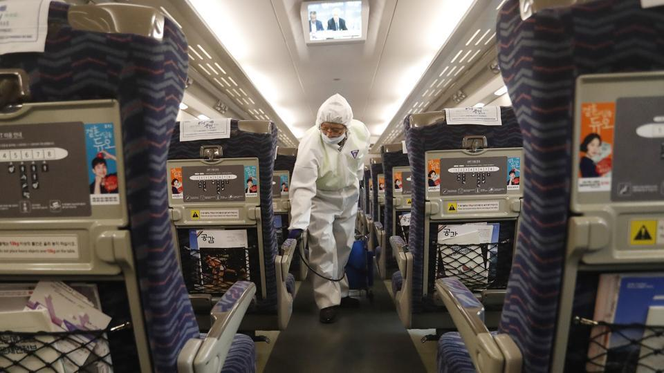 An employee sprays disinfectant on a train as a precaution against a new coronavirus at Suseo Station in Seoul, South Korea, Friday, Jan. 24, 2020.