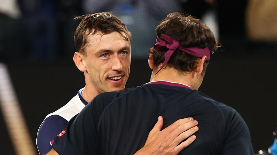 Switzerland's Roger Federer and Australia's John Millman hug each other after their match.