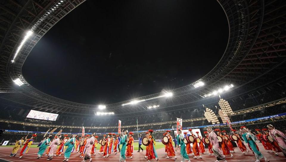 Dancers perform at the opening ceremony of the New National Stadium, the main venue for the Tokyo 2020 Olympic and Paralympic Games.