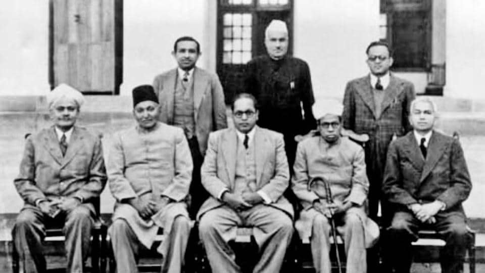 A photo of the drafting committee of the Constituent Assembly with its chairman BRAmbedkar in the centre.