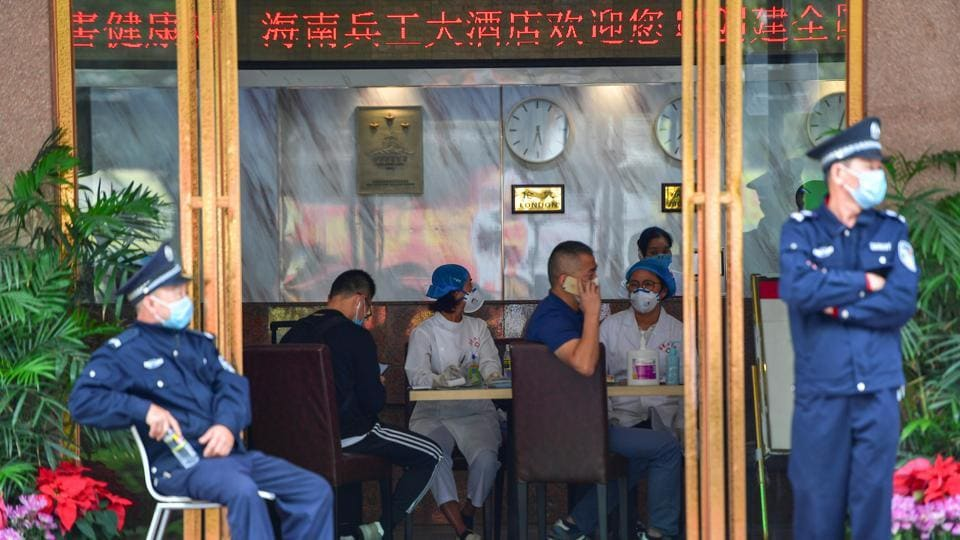 Medical staff at a hotel lobby where tourists from Hubei province will have 14-day centralised medical observation, in China's Haikou. Transportation has been shut down in Wuhan, the city of 11 million at the epicentre of the coronavirus outbreak, and in at least 18 other cities in the central Hubei province of China. (REUTERS)