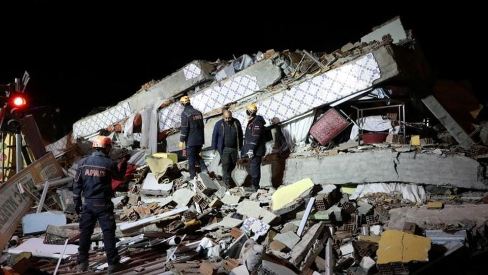 Rescue workers search on a collapsed building after an earthquake in Elazig, Turkey, January 25, 2020.