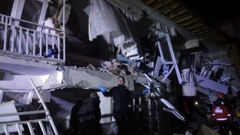 Rescuers outside a collapsed building after an earthquake in Elazig, Turkey.