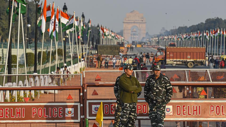 New Delhi: Security personnel stand guard at the Rajpath which is decked up for the Republic Day Parade, in New Delhi