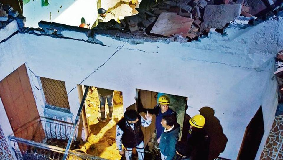 Rescue operation underway at the spot of a building collapse at Bhajanpura, in New Delhi on Saturday.