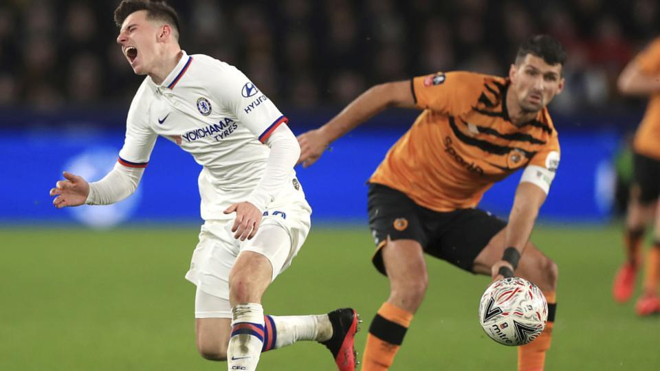 Chelsea's Mason Mount, left, reacts to a challenge from Hull City's Eric Lichaj.