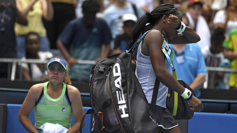 Coco Gauff, right, of the US reacts as she walks from the court.