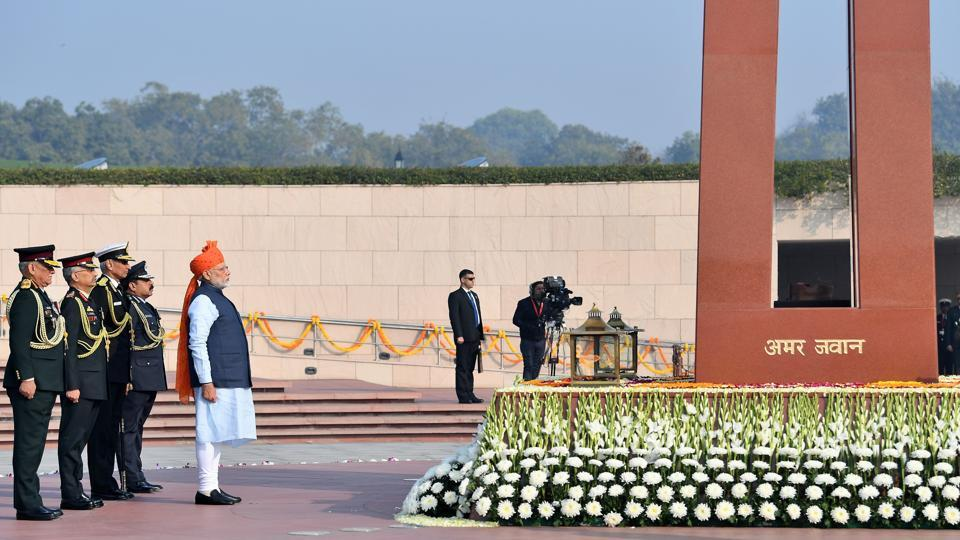 Prime Minister Modi greeted the nation early in the morning before the Republic Day ceremony started. The Prime Minister in a saffron turban, breaking from tradition, visited the National War Memorial instead of the Amar Jawan Jyoti, where he lead the nation in paying tributes to the martyrs by laying a wreath. (HT Photo)