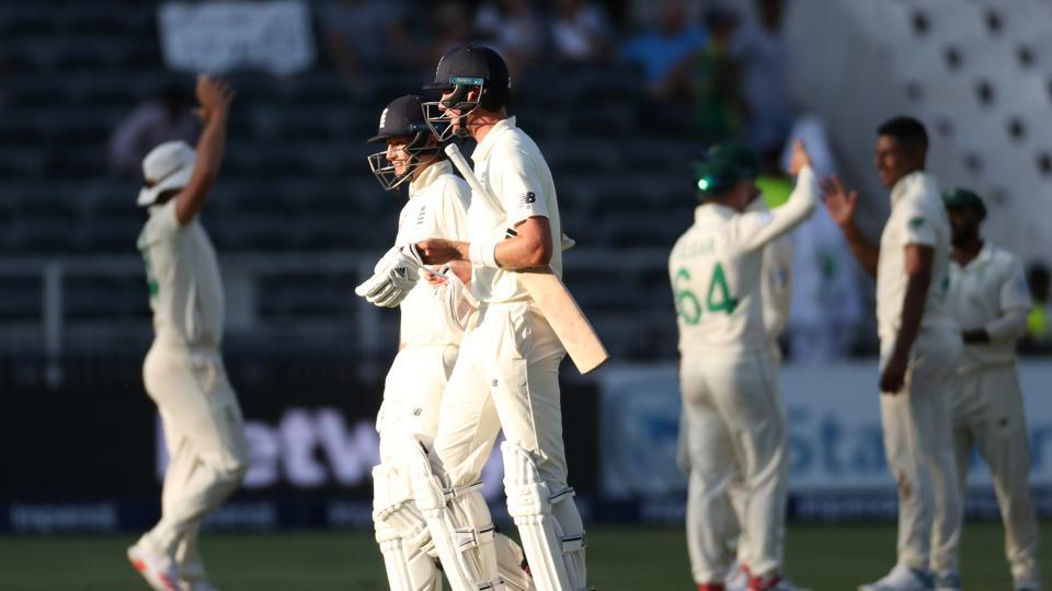 England's Joe Root and Stuart Broad walk off the pitch at stumps.