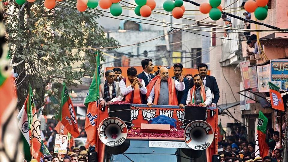 Home Minister Amit Shah accompanied by Manoj Tiwari during a road show ahead of Delhi assembly polls, at Ghonda in New Delhi, on Sunday, January 26, 2020.