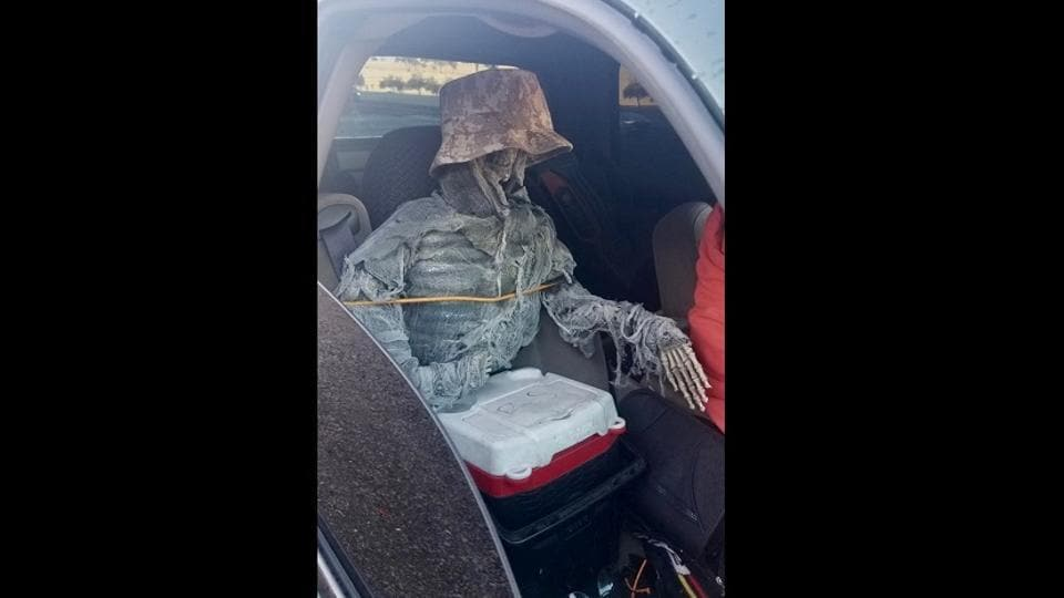 The skeleton was tied to the seat with rope and had a hat on to make it look more believable.