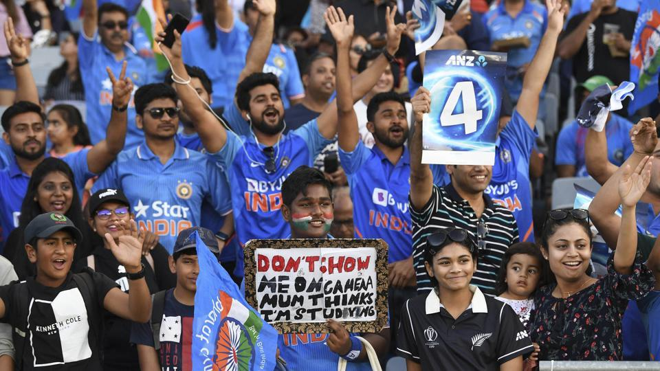 India fans and supporters cheer during the Twenty/20 cricket international between India and New Zealand in Auckland, New Zealand, Friday, Jan. 24, 2020.