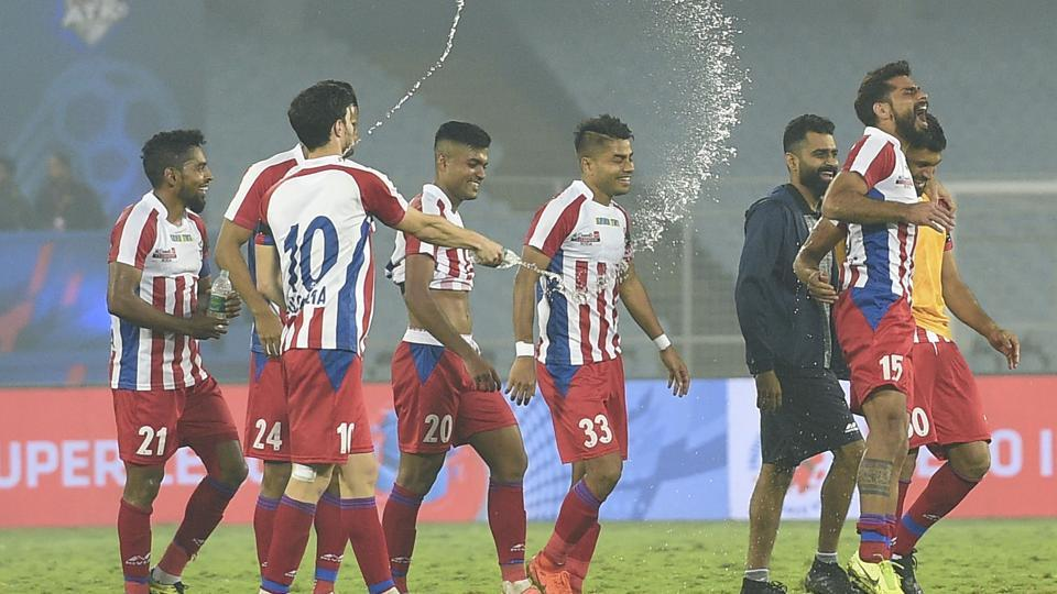 ATK players celebrate after wining against North East United FC during ISL match at Salt Lake Stadium in Kolkata.