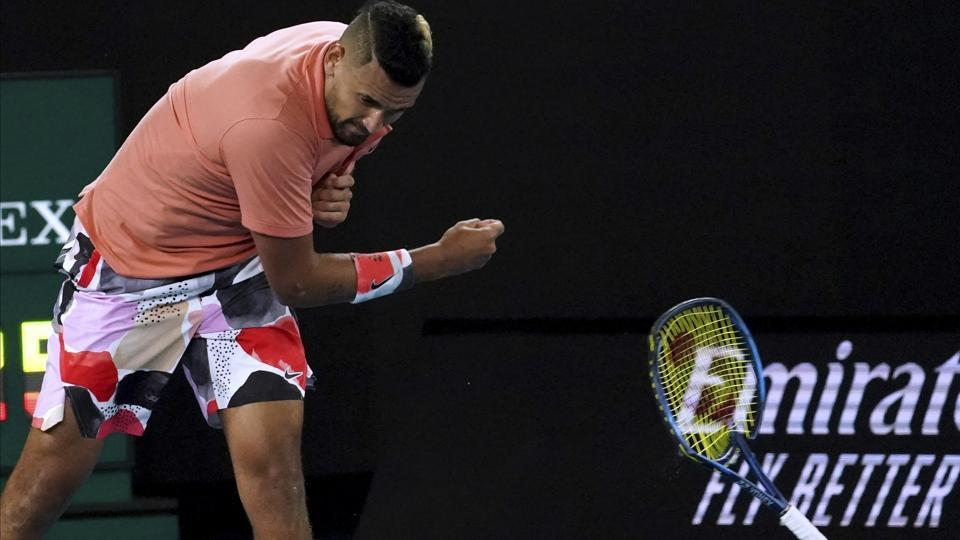 Australia's Nick Kyrgios smashes his racket in frustration.