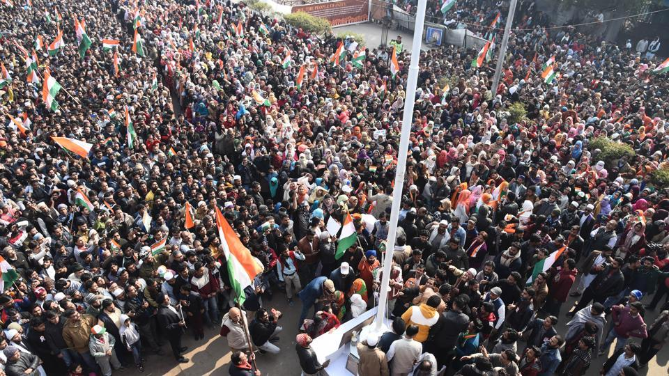 A massive crowd gathers to celebrate the 71st Republic Day at the site of an indefinite sit-in against the NRC, CAA and NPR in Shaheen Bagh, New Delhi on Sunday, January 26, 2020.