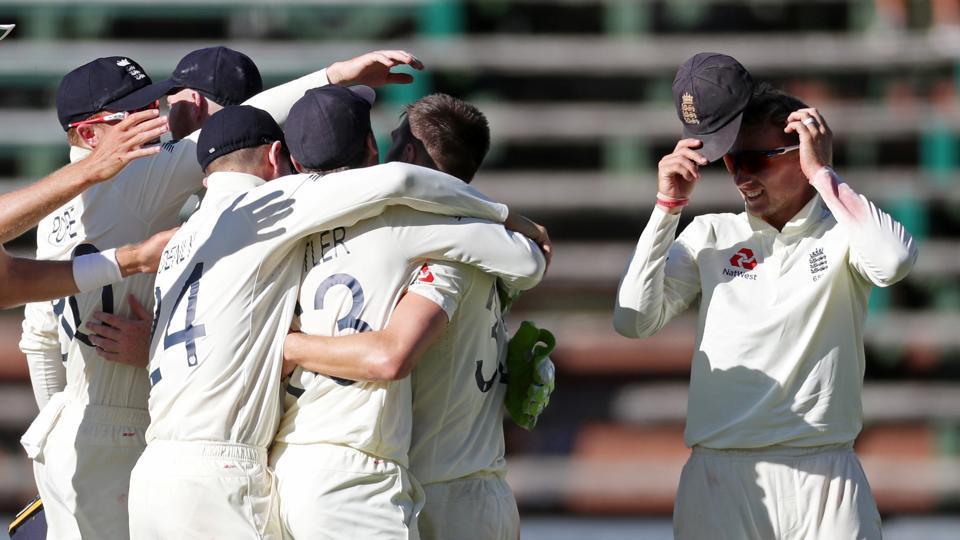 England's Mark Wood celebrates with Joe Root teammates.