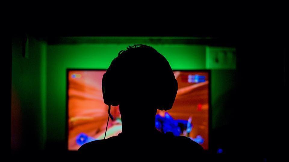 Gamer playing video game.