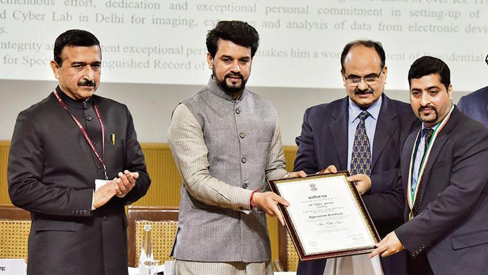 From left: CBIC chairman John Joseph, minister of state for finance and corporate affairs Anurag Thakur and revenue secretary Ajay Bhushan Pandey felicitate an awardee during the International Customs Day in New Delhi on Monday