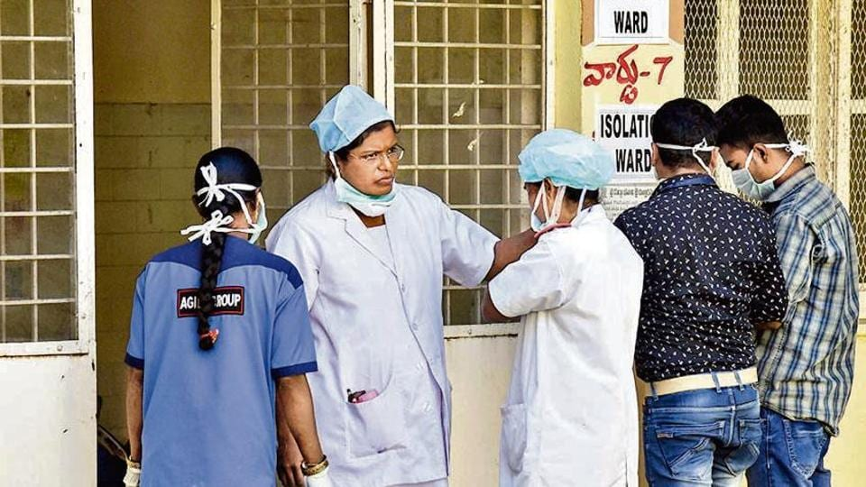 Hospital staff is seen outside the Special Isolation Ward set up to provide treatment to any suspected case of the coronavirus (CoV), in Hyderabad on Monday.