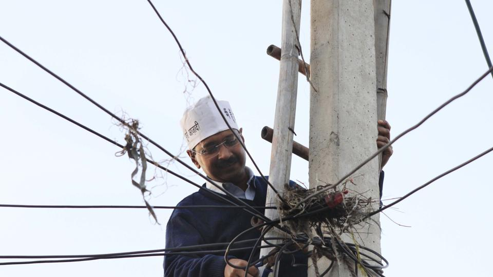 Arvind Kejriwal restore the Electric supply from pole which was disconnected by Tata Power Delhi Distribution Ltd, due to the unpaid bill of a residence at Begam Vihar on February 8, 2013 in New Delhi.