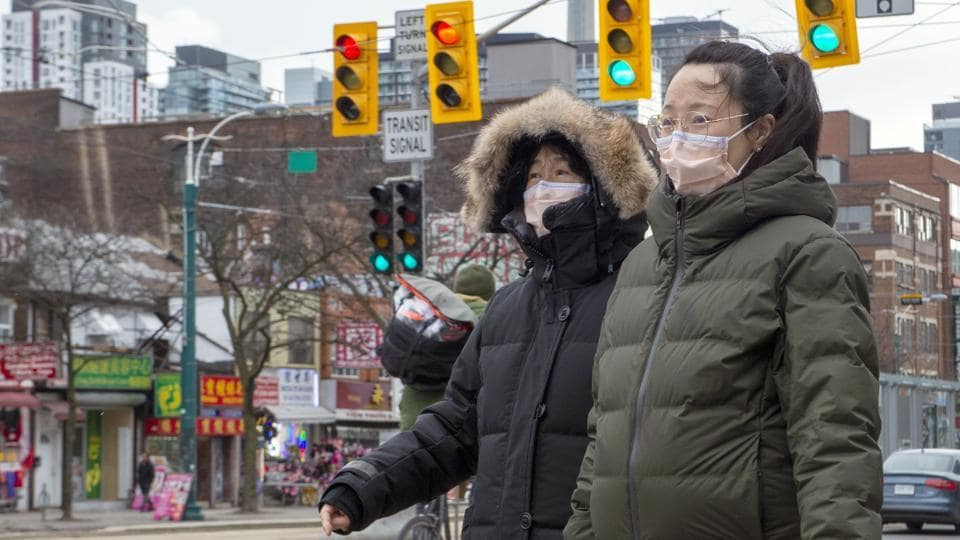 Pedestrians in China wear protective masks as Coronavirus spreads across the country and world.